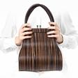Tomaž Lipovec navdušuje z lesenimi torbicami
