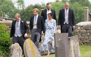 Meghan Markle padala po travi, princ Harry jo je ujel v zadnjem hipu