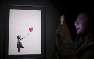 Lastnica deloma samouničene Banksyjeve slike bo nakup izvedla do konca
