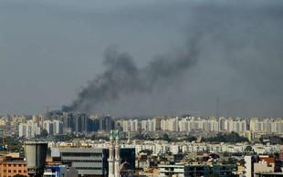 V napadu na migrantski center pri Tripoliju več deset mrtvih